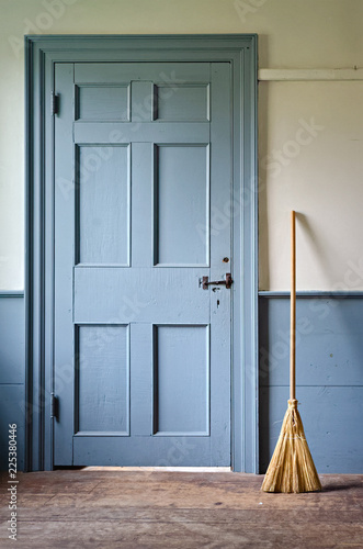 Fotografie, Tablou  Handmade Broom Beside Vintage Blue Door in Old House
