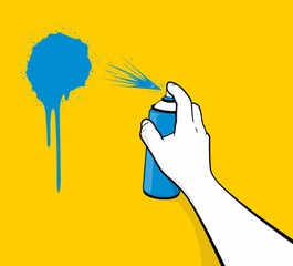 Man hand using blue spray painting