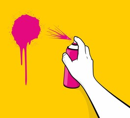 Man hand using pink spray painting