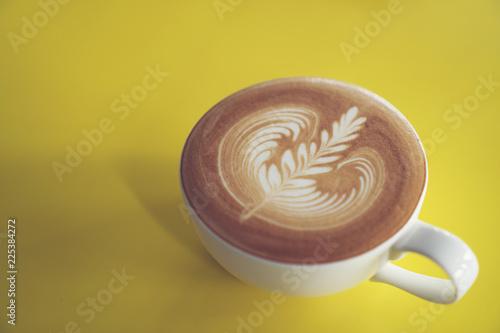 Fotografie, Obraz  latte art on yellow cafe table, coffee cafe