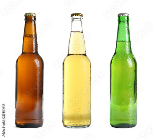 Set with different cold beer bottles on white background Canvas Print