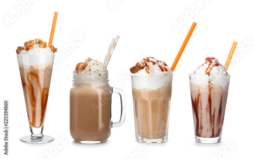 Set with delicious caramel milk shakes on white background