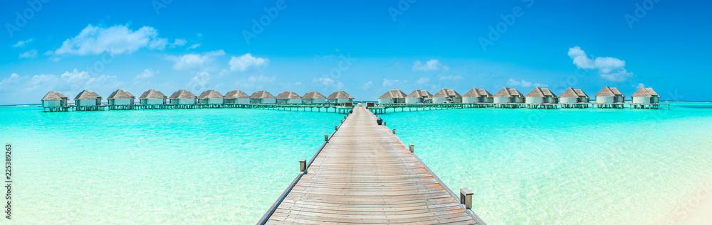 Fototapeta Overwater bungalow in the Indian Ocean