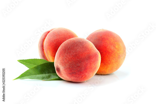Fresh peach fruits with leaf isolated.