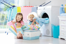 Kids In Laundry Room With Wash...