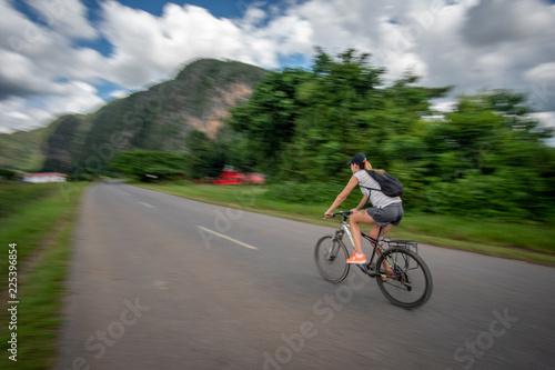 Photo Girl on the bike in Viniales, Cuba