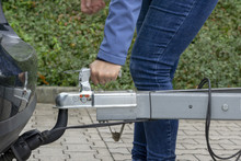 """Woman Couple A Trailer (i.s., """"hooked"""") Into A Ball-type Tow Hitch"""