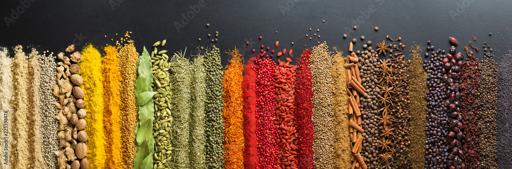 Fototapety, obrazy: Colorful collection spices and herbs on background black table. Mediterranean condiments for decorating packing with food.