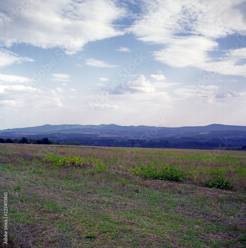 Fotobehang Blauwe hemel landscape with mountains and clouds