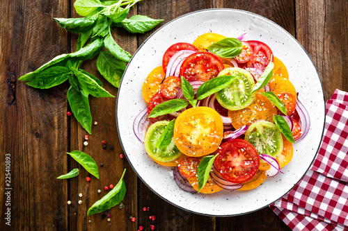 Tomato salad. Fresh vegetable salad with tomatoes, onion and basil