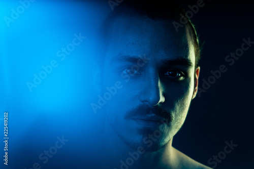 Fototapeta Cinematic portrait of man with lights and prism