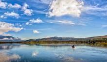 Kayaking On A Pristine Mountain Lake In Alaska