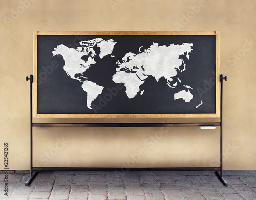 Image of a world map drawn in white chalk on a blackboard
