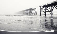 Broken Pier Waves And Beach