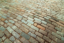 Cobblestone Road. Big Stones On Ground Close Up. Road Surface. Top View. Selective Focus