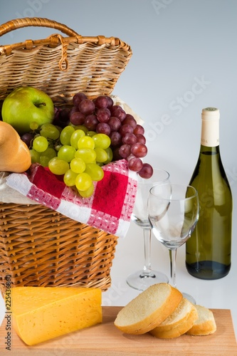 Picnic Basket And Wine With Cheese And Bread Close-up
