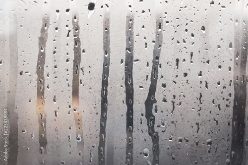 Wet, steamy glass windows with gray steam and water droplets as background Tablou Canvas
