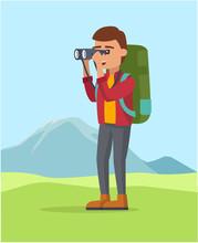 A Guy Seeing Trough The Binocular Backpaking