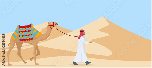 young arab guy walking his camel trough desert Fototapet