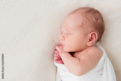 Cute newborn baby sleeping on white background. Top view