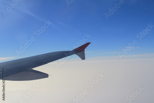 Ailerons and flaps tucked flat in airplane wing at cruise speed Canvas Print