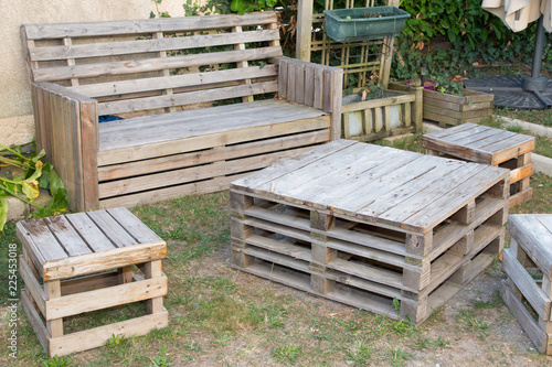 Slika na platnu vintage wooden recycled palets make table and bench in house garden