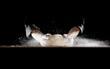 Man slamming dough into table causing flour to fly