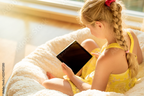 Girl using tablet computer at home