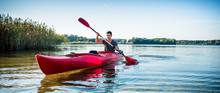 Portrait Of Man Kayaking On Id...