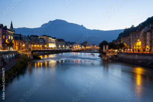 Grenoble at dusk with the river Isere, France