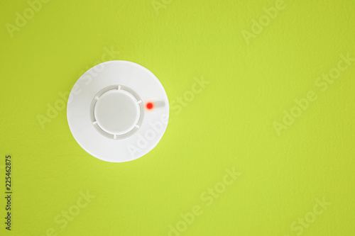 Photo  Smoke detector on yellow background. Security system.