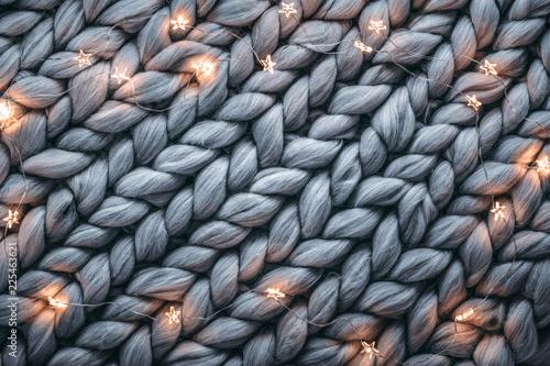 Christmas lights on warm woolen sweater