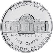 Five American Cents On A White...