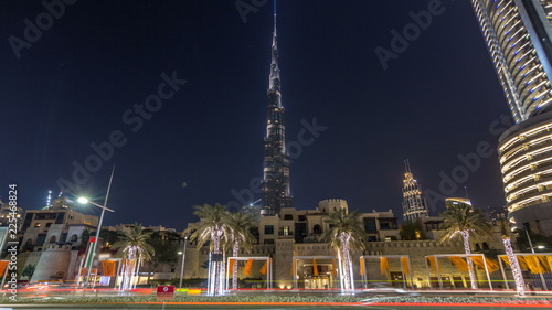 View on modern skyscrapers and busy evening road timelapse hyperlapse in luxury Dubai city, Dubai downtown, United Arab Emirates