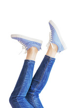Woman Legs In A Blue Jeans On White Background Isolated