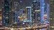Water canal on Dubai Marina skyline at night timelapse.