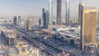 Dubai downtown skyline at sunset timelapse and road traffic near mall, UAE