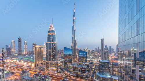 Wall Murals Dubai Dubai downtown skyline day to night timelapse with tallest building and Sheikh Zayed road traffic, UAE