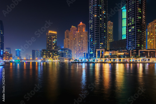 Beautiful view to Dubai Marina Promenade, UAE. Long exposure effect at night