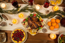 Christmas Dinner And Eating Concept - Roast Chicken Or Turkey And Other Food On Table