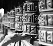 Buddhist Prayer Wheels And A Hand