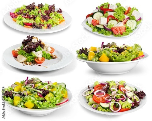 Different kinds of salads on background