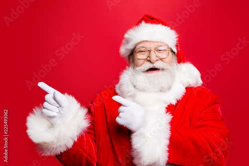Photo Funky rejoice stylish Santa in costume gloves headwear and spect