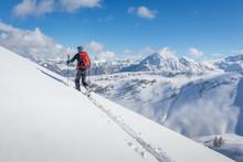 Male Ski Tourer Walking Up A S...