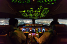 Asian Airline Pilots Were Operating Commercial Aircraft On Approach Phase Over City On The Night. Both Pilots Have To Pay Special Attention On This Most Critical Phase Of The Flight Before Landing.