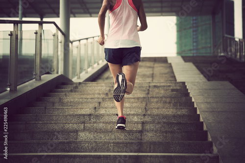 In de dag Jogging Young woman runner sportswoman running up city stairs jogging and running in urban training workout