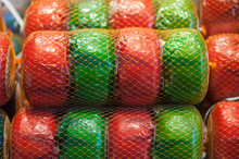 Net Of Green And Red Wheels Of Gouda Cheese