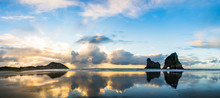Panorama View. The Beautiful Wharariki Beach With Famous Rocks. Sunset Scene Golden Light And Silhouette. Nelson, South Island, New Zealand.
