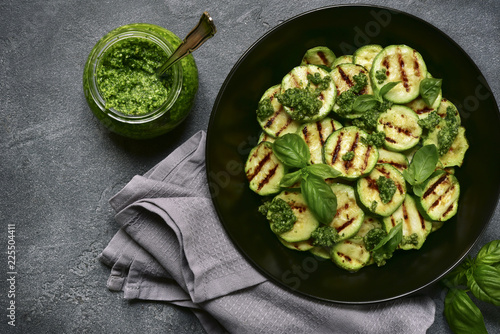 Grilled zucchini slices with pesto sauce.Top view.