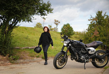 Woman And Retro Cafe Racer Mot...